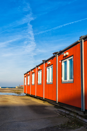 modular home: Conventional shipping containers housing on a bright sunny day