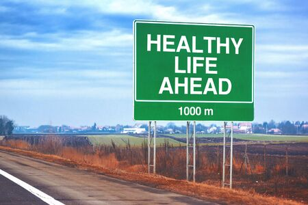 forthcoming: Healthy life ahead traffic sign at roadside, forthcoming health benefits metaphor.