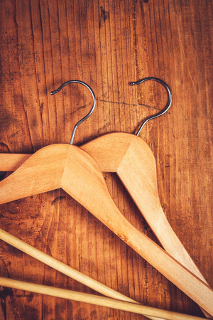 coathanger: Two retro cloth hangers on rustic wooden background, top view with copy space Stock Photo