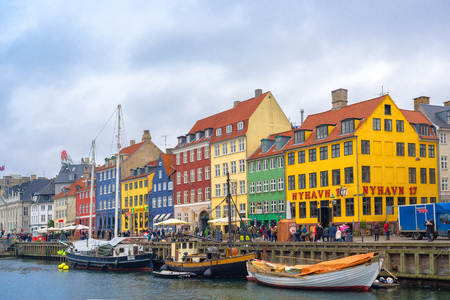 entertainment district: COPENHAGEN, DENMARK - DECEMBER 30, 2015: Copenhagen Nyhavn canal and promenade with its colorful facades, romantic place is a 17th century waterfront, nowdays an entertainment district and famous landmark in Danish capital. Editorial