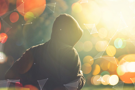overlaying: Male jogger running outdoors in morning, hooded man in the park, retro toned image with selective focus and bokeh light, modern futuristic shape graphics overlaying image. Stock Photo