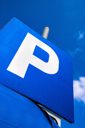 low  angle: Blue parking sign against blue sky, unusual low angle perspective Stock Photo