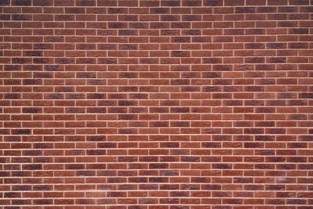 Exposed red vintage brick wall texture, brickwork pattern as background Standard-Bild