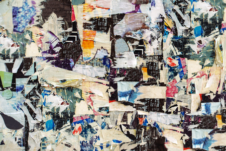 wall paper texture: Advertising posters paper scraps on wall as urban background, torn paper ads texture. Stock Photo