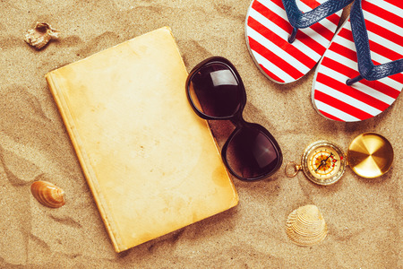 Beach ready, summer holiday vacation accessories on sandy beach, summertime lifestyle objects in flat lay top view arrangement.