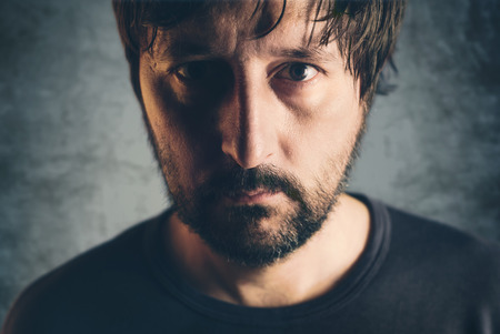 unshaven: Dramatic low key portrait of adult male, headshot of sad lonely unshaven person, selective focus Stock Photo
