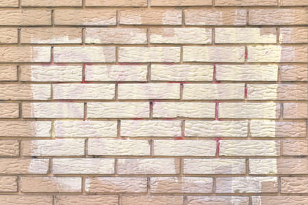 acts: White paint out covering graffiti sprayed messages on brick wall, removing acts of vandalism. Stock Photo