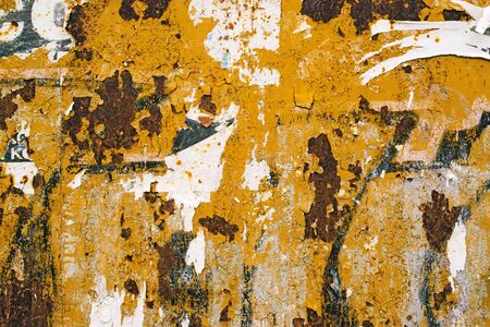 corroded: Corroded metal plate texture and poster paper scraps, abstract background