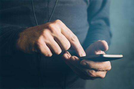 mobile communication: Man sending text message, sms communication using mobile smartphone Stock Photo
