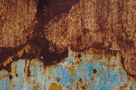 corroded: Detail of corroded metal plate with blue paint peeled of oxidized metal plate texture Stock Photo