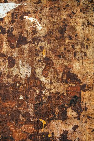 scrap metal: Detailed texture of old rusty metal plate surface, brown corroded scrap metal piece.