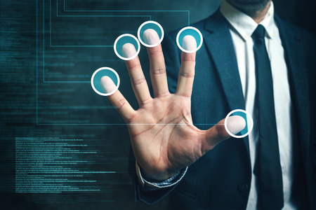 verification: Businessman passing biometric verification with fingerprint scanner, modern futuristic technology in service of security and business protection. Stock Photo