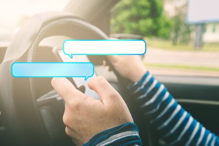 car wheel: Female driving car and texting on smartphone with speech bubbles as copy space for message, using mobile phone in traffic.