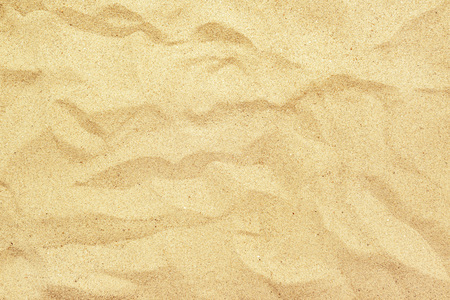 Top view of hot yellow beach sand texture, summer holiday vacation background. Stock Photo
