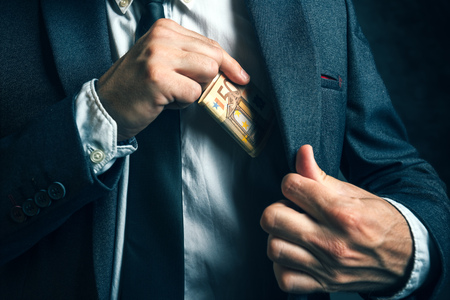 hand with money: Money in pocket, businessman putting euro banknotes in suit pocket, bribe and corrupution concept.