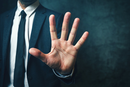 body parts: Businessman with long fingers, concept of relation between body parts and intelligence Stock Photo