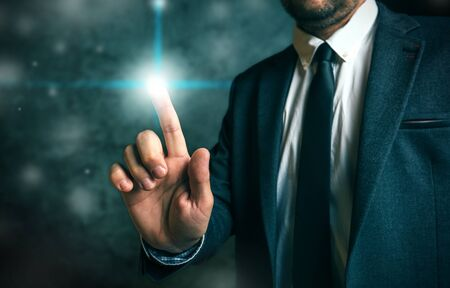 press button: Businessman pushing virtual screen interface button, concept of modern futuristic technology in service of business and entrepreneurship.