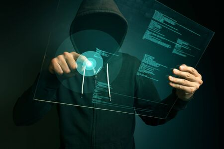 Hooded computer hacker hacking biometric security internet system, fingerprint identification app on futuristic tablet computer device, Stock Photo - 58519077