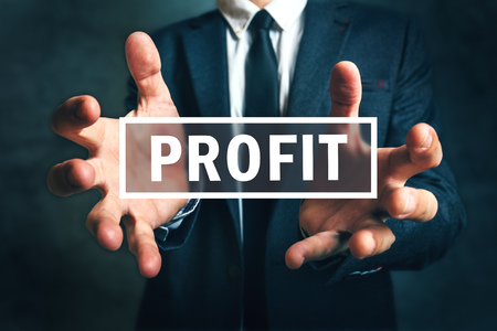proceeds: Concept of gaining business profit, businessman grabbing profit with his hands Stock Photo
