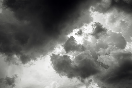 obscuring: Dark stormy clouds obscuring sun - nature, climate change, weather or meteorology background.