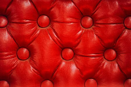 vintage furniture: Texture of vintage red leather upholstery with buttons, retro furniture background