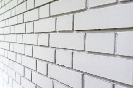 perspectives: White exterior brick wall perspective, urban background, selective focus Stock Photo