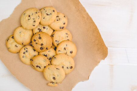 chocolate cookies: Homemade chocolate chip cookies on rustic wooden table, top view Stock Photo