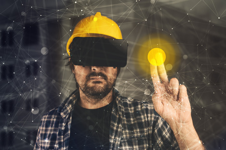 industry architecture: Construction engineer with VR goggles managing building project, futuristic 3d cyberspace technology in architecture and construction industry