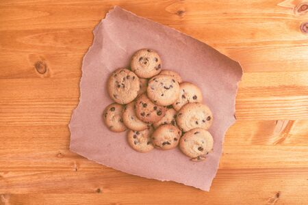 domestic life: Sweet homemade american chocolate chip cookies on rustic wooden table, top view