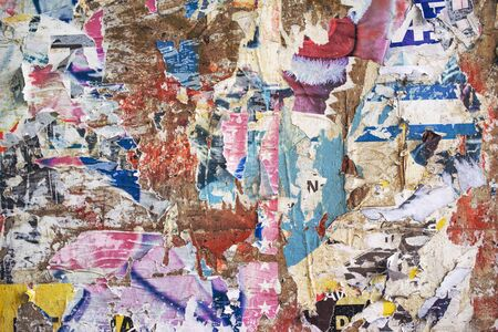 wall paper texture: Paper scraps texture, torn posters on exterior wall