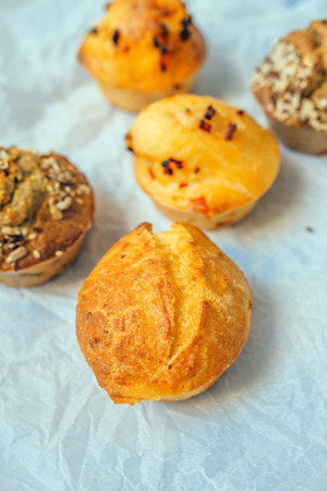 corn flour: Homemade salty muffins, also called proja pie, traditional Balkans baked food with savory cheese, ham, eggs and paprika made of corn flour starch, selective focus.