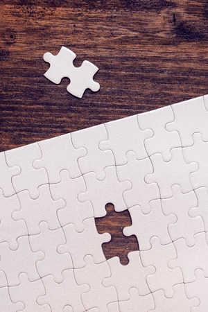 missing piece: Jigsaw puzzle with one missing piece left to complete, copy space, top view Stock Photo