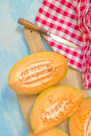 elective: Honeydew or cantaloupe melon on rustic table, elective focus Stock Photo