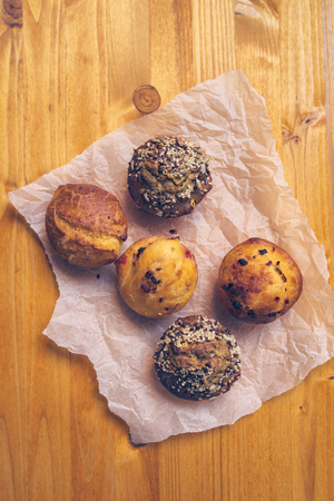 starch: Homemade salty muffins, also called proja pie, traditional Balkans baked food with savory cheese, ham, eggs and paprika made of corn flour starch, selective focus.