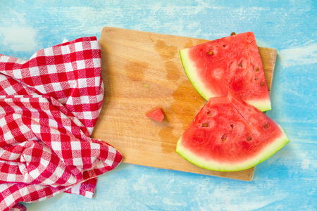 mouthwatering: Watermelon slices on wooden board, top view, selective focus