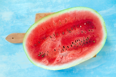 mouthwatering: Watermelon cross section slice on rustic wooden table, top view selective focus