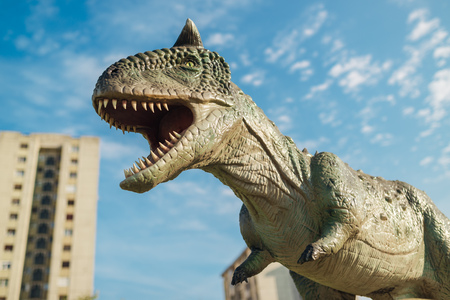 bipedal: NOVI SAD, SERBIA - AUGUST 7, 2016: Carnotaurus life size model of prehistoric animal in theme entertainment Dino Park. This was bipedal predator, measuring 8 to 9 m. Editorial