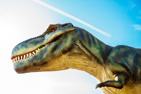 one animal: NOVI SAD, SERBIA - AUGUST 7, 2016: Tyrannosaurus life size model of prehistoric animal in theme entertainment Dino Park. T-rex was one of the largest land carnivores of all time. Editorial