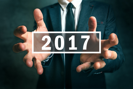 taxation: Business opportunities in 2017, businessman making plans for the new year. Stock Photo