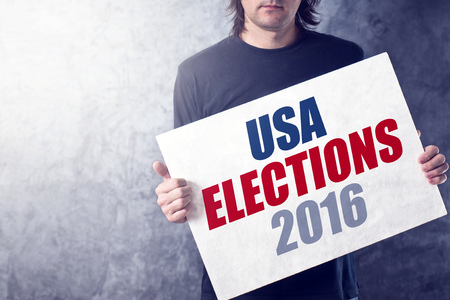 presidential: USA elections 2016, man holding poster for presidential rally