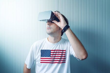 visions of america: USA guy exploring virtual reality environment and enjoying multimedia content in 3d. Stock Photo