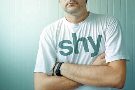 humble: Adult man wearing shirt with Shy title