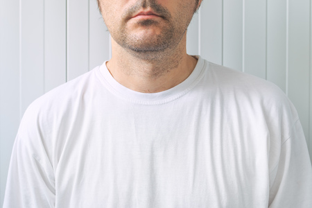 informal clothes: Casual adult male wearing blank white t-shirt as copy space for graphic design mock up