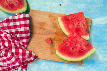 red cloth: Watermelon slices, top view, selective focus