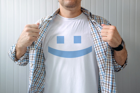 reveal: Man stretching shirt to reveal smiley emoticon printed on chest