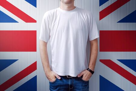 adult wall: Man standing in front of United Kingdom flag wall, adult male person supporting Great Britain