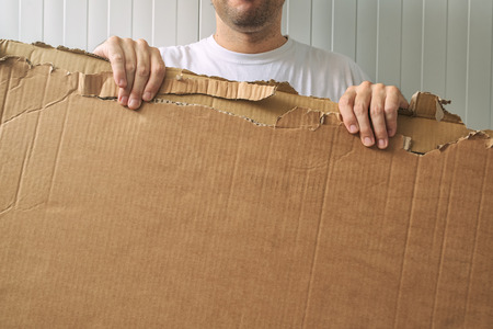 blank space: Man holding blank cardboard as copy space for your message Stock Photo