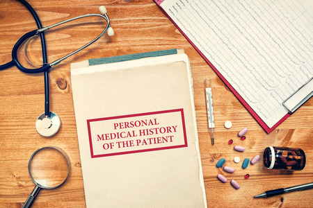 personal record: Personal medical history of the patient, healthcare concept with doctors worskpace top view Stock Photo