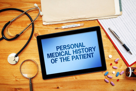 Personal medical history of the patient, healthcare concept with doctor's worskpace top view