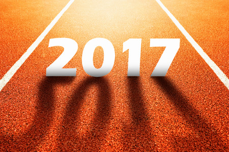 competitive sport: 2017 Happy New Year, athletics sport running track concept with number two thousand and seventeen Stock Photo